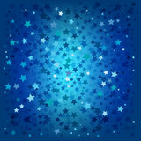 Abstract christmas blue stars background. Abstract christmas stars on a blue background Stock Photos