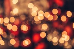 Christmas bokeh light abstract holiday background. Abstract Christmas bokeh background. Red black and yellow colors Royalty Free Stock Photography
