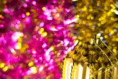 Abstract Christmas bokeh background. Unfocused tinsel close up shot. stock photography