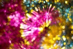 Abstract Christmas bokeh background. Unfocused tinsel close up shot. stock images