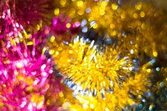 Abstract Christmas bokeh background. Unfocused tinsel close up shot. royalty free stock photography