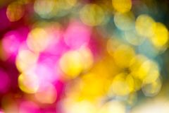 Abstract Christmas bokeh background. Unfocused tinsel close up shot. royalty free stock images