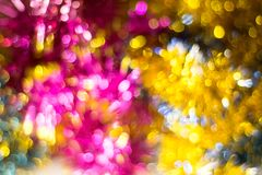 Abstract Christmas bokeh background. Unfocused tinsel close up shot. stock photos