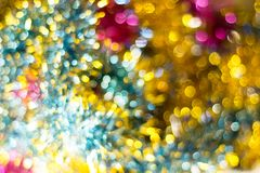 Abstract Christmas bokeh background. Unfocused tinsel close up shot. royalty free stock photo