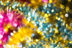 Abstract Christmas bokeh background. Unfocused tinsel close up shot. royalty free stock photos