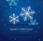 Abstract Christmas card with snowflakes. On blue background Stock Images