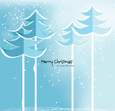 Abstract Christmas card with snowy trees. Christmas card with snowy trees on blue background Royalty Free Stock Images