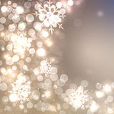 Abstract Christmas card with white and golden shining snowflakes Royalty Free Stock Images