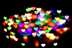 Abstract christmas color lights background - hearts Stock Images