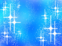 Abstract christmas design with white stars on blue. Abstract christmas design with white glowing stars on blue background Stock Photography