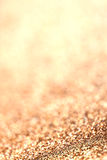 Abstract Christmas Glitter background with golden  lights. Royalty Free Stock Images