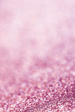 Abstract Christmas Glitter background with pink lights. Festive Royalty Free Stock Image