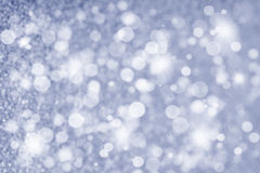 Abstract Christmas Glittering background in silver Stock Photo