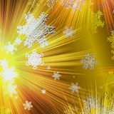 Abstract christmas glowing background with gold rays and snowflakes Stock Photography