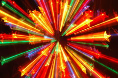 Abstract Christmas lights. Star-shaped Christmas lights in abstract defocused design royalty free stock images