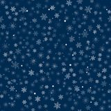 Abstract Christmas seamless pattern from white snowflakes on a blue background. For holiday, new year, celebration, party. Stock Image