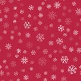 Abstract Christmas seamless pattern from white snowflakes on red background. For holiday, new year, celebration, party. Royalty Free Stock Images