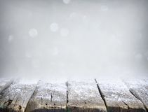 Abstract christmas silver background with empty wooden table and snow royalty free stock images