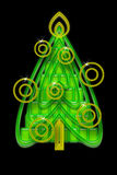 Abstract Christmas Tree. Bright Abstract Geometric Green Christmas Tree with Yellow Baubles and Sparks over Black Night Background Royalty Free Stock Image