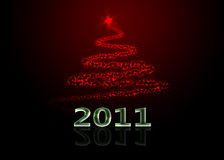 Abstract christmas tree. Abstract red christmas tree made of stars and stardust with 2011 text Royalty Free Stock Image