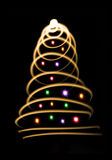 Abstract christmas tree. On black background Stock Photos