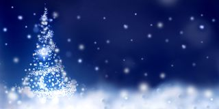 Abstract christmas tree in snow stock photos