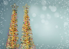 Abstract Christmas tree on blue snowy background Royalty Free Stock Photo
