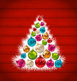 Abstract Christmas tree and colorful balls on wooden background Royalty Free Stock Image