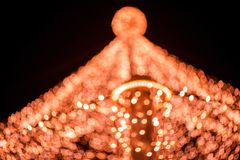 Abstract Christmas background. Abstract Christmas tree, colorful, blurry background. Glowing and sparkling lights in city center in Christmas market royalty free stock photo