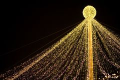Abstract Christmas background. Abstract Christmas tree, colorful, blurry background. Glowing and sparkling lights in city center in Christmas market stock photography