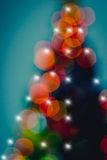 Abstract Christmas tree with defocused lights Royalty Free Stock Photos