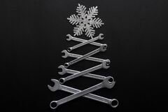 Free Abstract Christmas Tree Made Of Wrenches With Snowflake On The Top On Black Background. Industrial Christmas, Winter, New Year. Royalty Free Stock Photos - 188832558