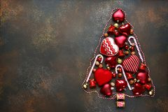 Abstract christmas tree made from red christmas toys.Top view. stock image