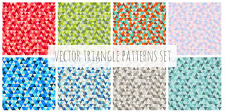 Abstract Christmas triangle patterns set. Red, blue, green, brown, purple vector winter seamless backgrounds Stock Photography