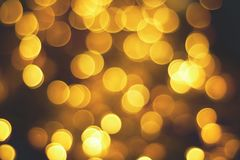 Abstract Christmas warm light celebration bokeh background with de focused lights texture. stock images