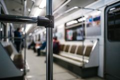 Abstract chrome handrails. In subway wagon interior royalty free stock image