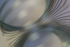 Abstract chrome spring. Chrome metal silver blue spring close-up abstract background pattern circular Stock Photo