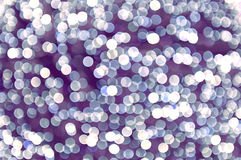 Abstract circle lights on a lilac background Stock Image