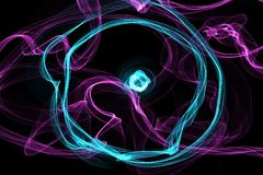 Abstract circle wave motion glowing lines on dark background. Circle Waves of glowing lines in different shapes and colors Royalty Free Stock Images
