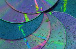 Abstract circles background. CDs SD multicolor water drops background royalty free stock photography