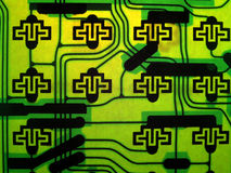 Abstract Circuit Pattern. Circuits make abstract pattern when backlight through board royalty free stock photo