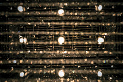 Abstract circular bokeh  background of chandelier lamps. Stock Images