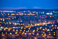 Abstract circular bokeh city lights with horizon colorful backgr Royalty Free Stock Images