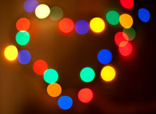 Abstract circular bokeh in the form of heart. Of christmas lights for background Royalty Free Stock Photos