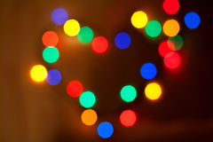 Abstract circular bokeh in the form of heart. Of christmas lights for background Stock Photos