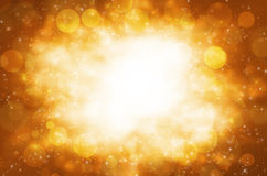 Abstract circular bokeh with golden background. Stock Photos