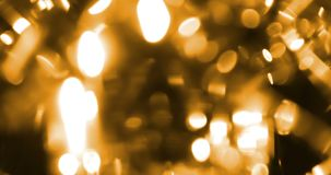 Abstract circular golden sparkle glitter bokeh flowing movement on black background, congratulation greeting party happy new year stock video