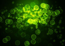 Abstract circular green bokeh background. Stock Image