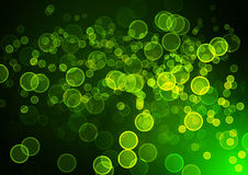 Abstract circular green bokeh background. Stock Photos