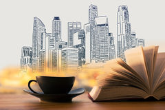 Abstract city sketch. Abstract coffee cup and open book on light background with city sketch Royalty Free Stock Images